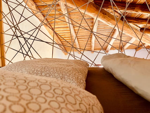 Sweet Dreams in the Mezzanine Bed under the wooden roof