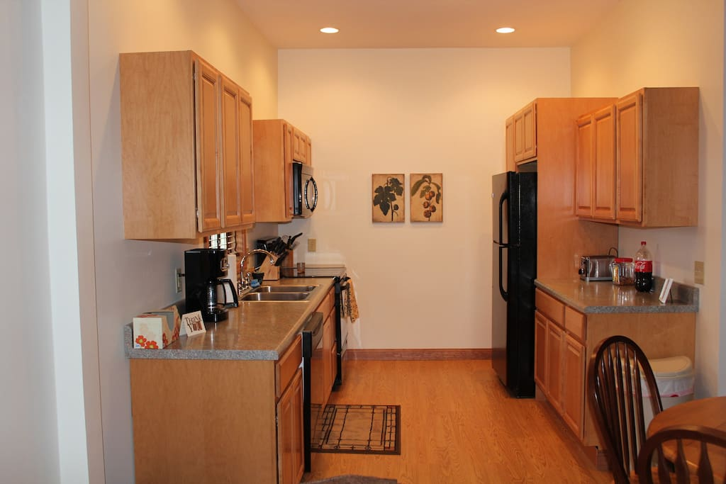 Kitchen with electric range, microwave, dishwasher and refrigerator