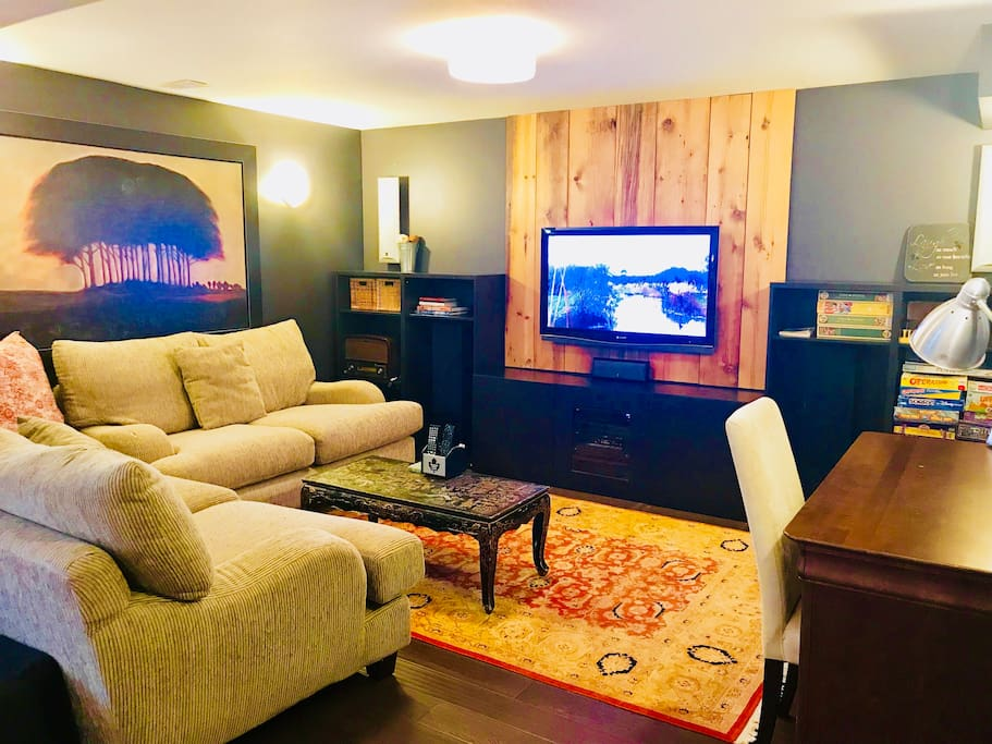 Living Room/TV area with very deep, soft couches. Bell Satellite and Netflix connectivity (with your own account), board games, puzzles and more