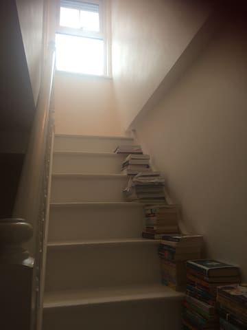 The private staircase to your room. A choice of reading books on the stairs :-)