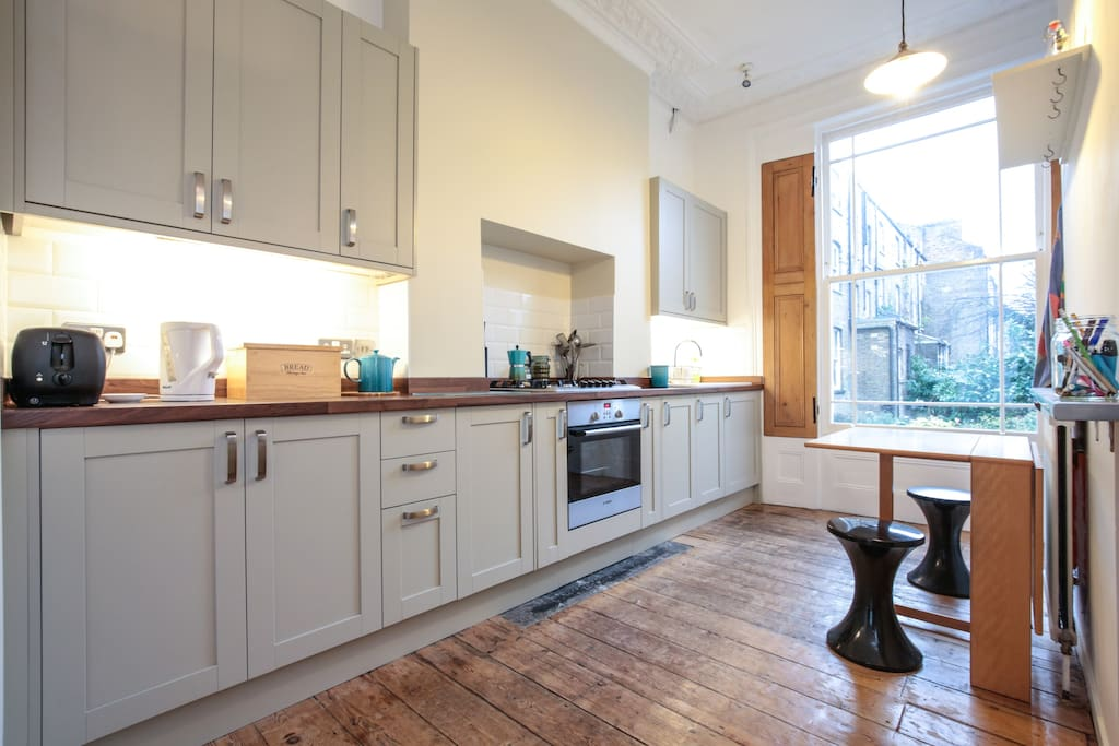 Our light and airy brand new fitted kitchen with large sash window overlooking the walled garden.