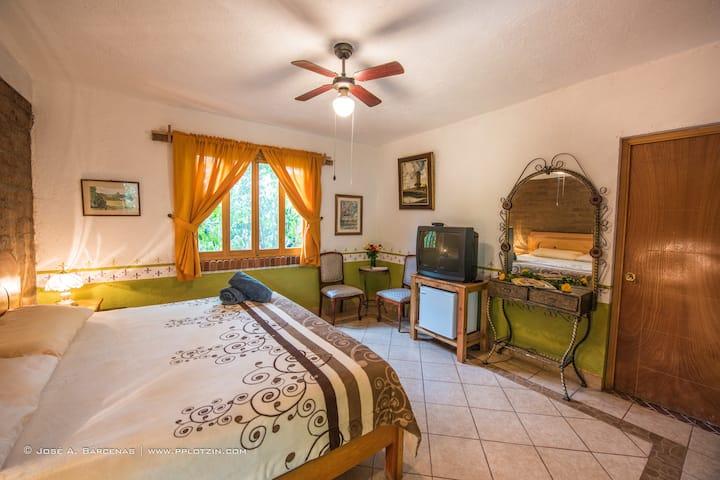 hotel casa pomarrosa con cama extra grande