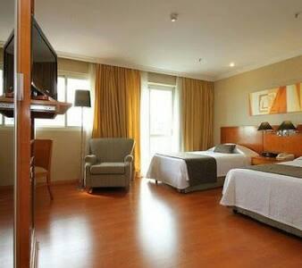 Suíte, cozinha integrada / Serviço de Apart Hotel