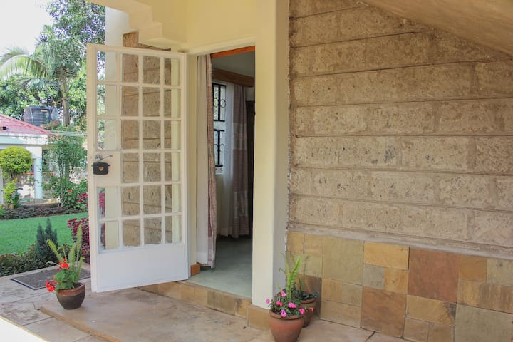 Secure guest suite with lovely garden view