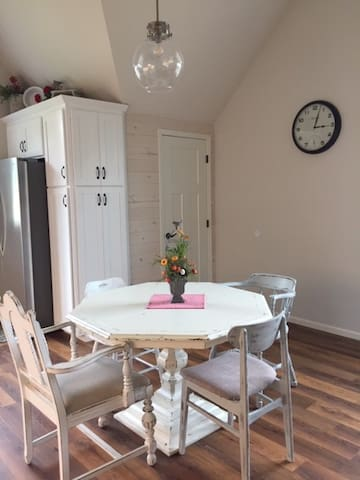 Spacious kitchen area.  Table comfortably seats four adults.  High chair in hall closet for toddler seating.