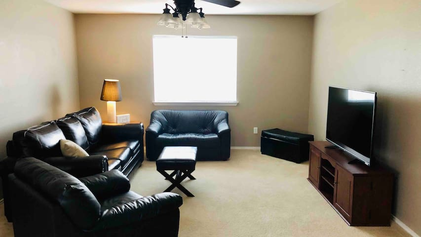 Cuddle up under a blanket to watch a movie or the big game in our upstairs media room with 55in Smart TV with access to all your favorite streaming services!  The couch is a queen sleeper sofa with additional pillows and blankets provided.