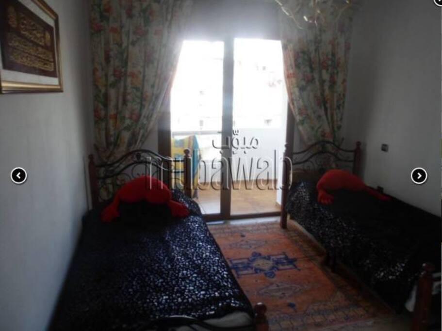 chambre avec balcon et vue sur l'océan.