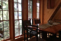 dining area with full length windows for serene views of the river
