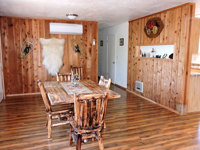 Dining area with log furniture.