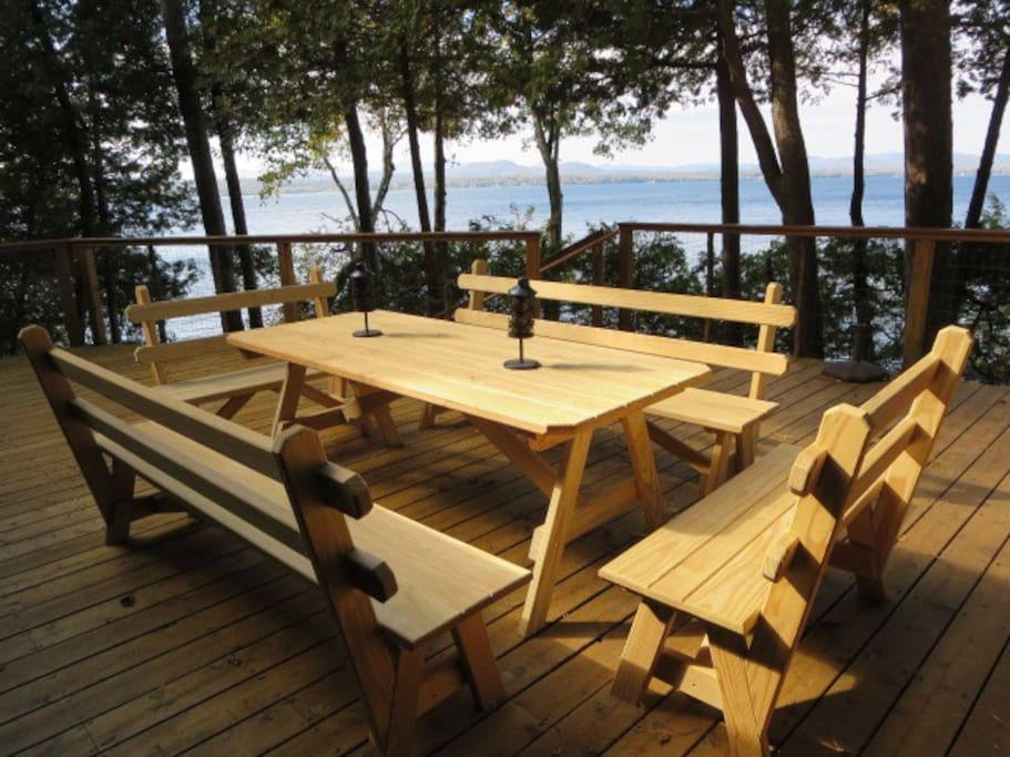 Take in the sunset on the large cedar deck with lake and mountain views