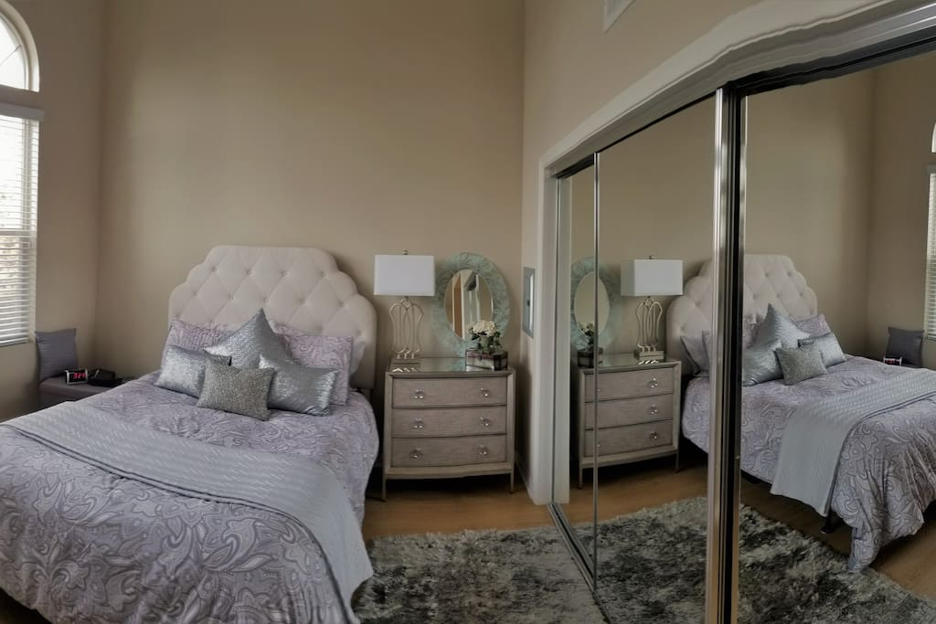The bedroom is comfortable and spacious!