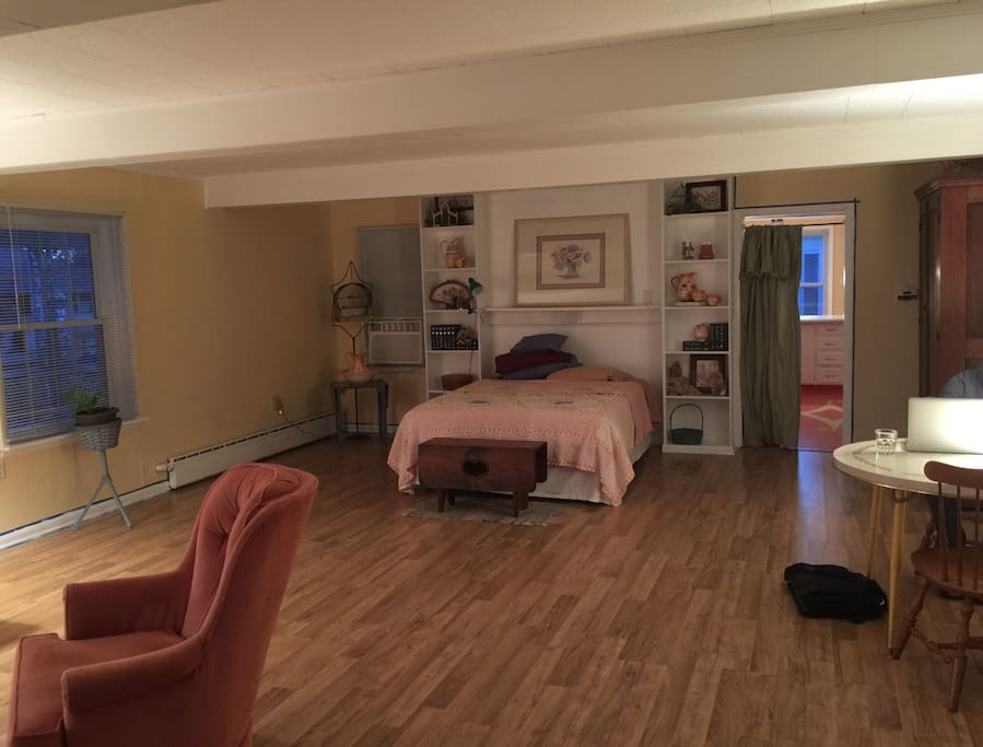 Bed and entrance to room from kitchen Pic to be updated asap has dresser with mirror and headboard on  the bed