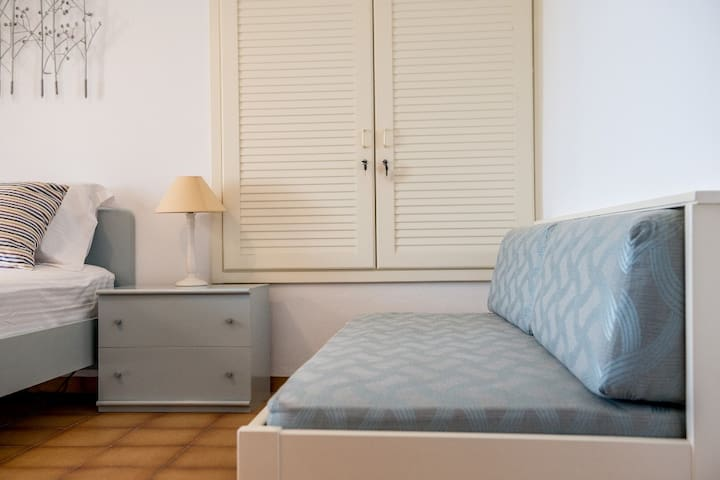 Sea View Bedroom with double bed and sofa bed