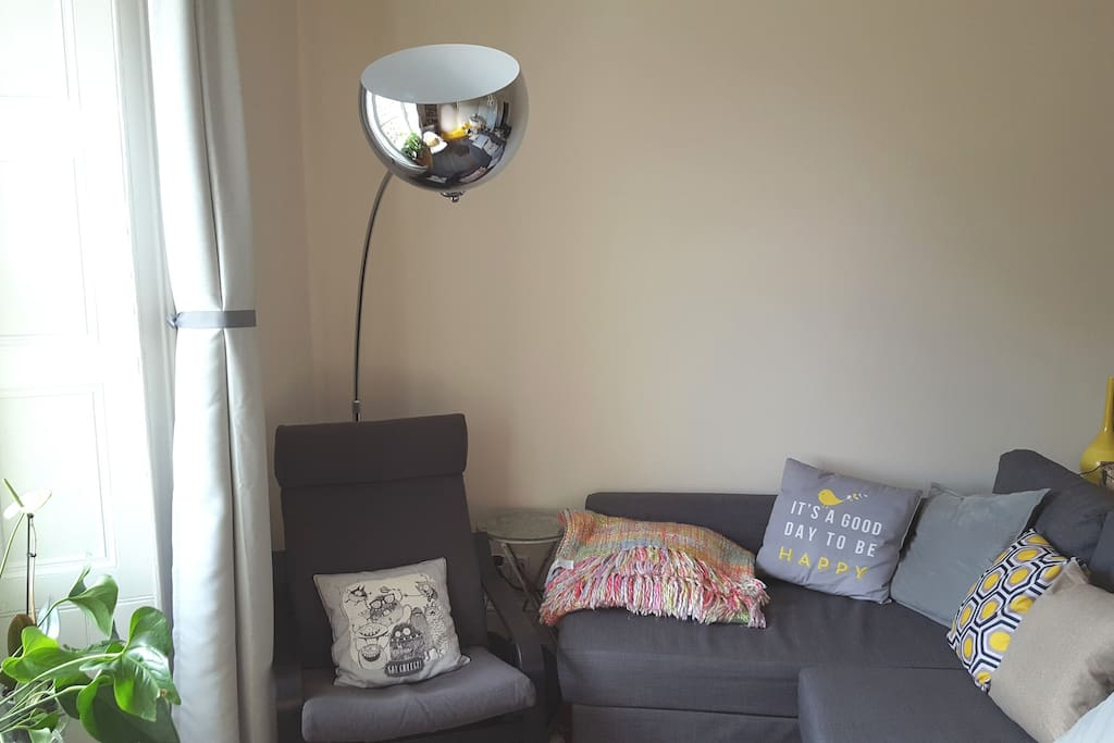 The living room is large and quiet and comes with a comfy queen size sofa bed that accommodates any additional guests