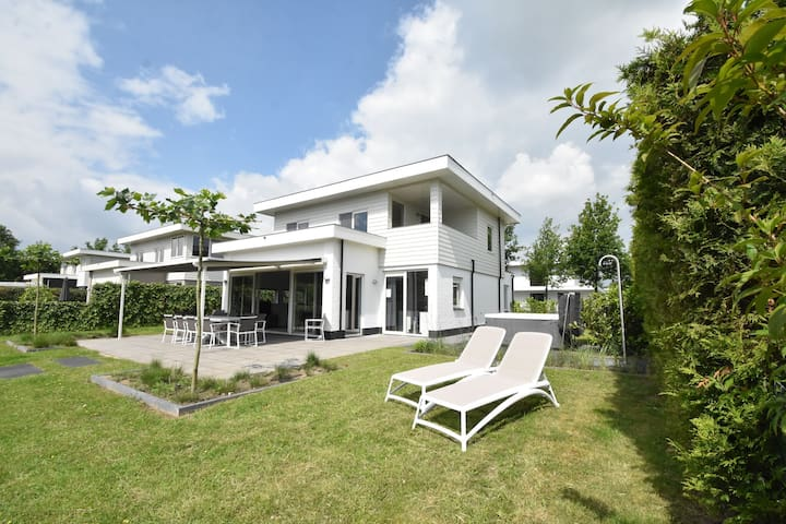 Modern villa with large garden by the water, with jacuzzi and sauna infrared