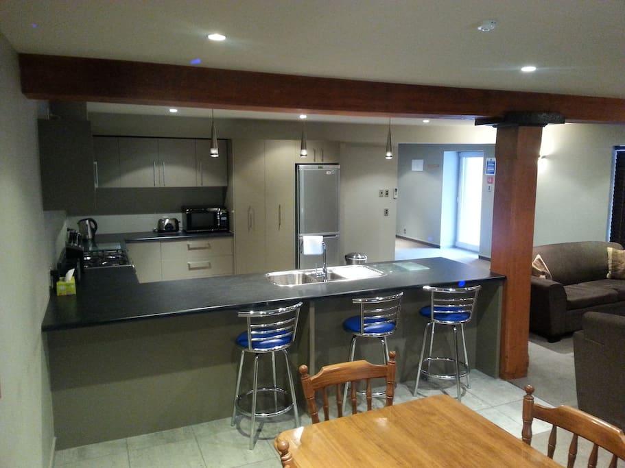 Looking towards kitchen area