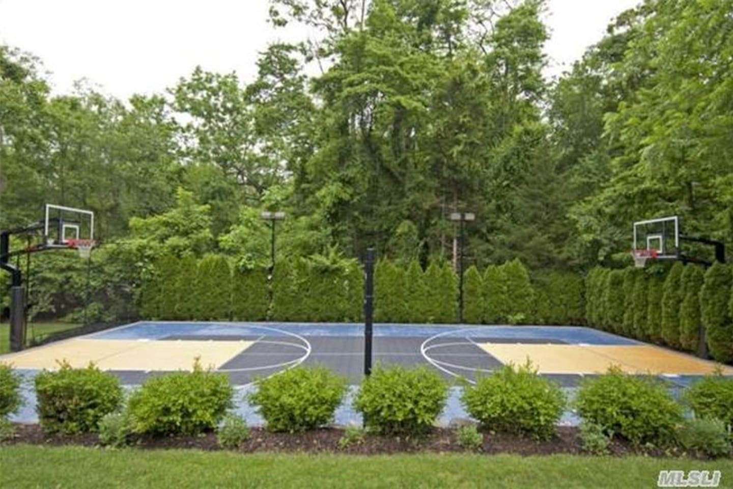 Full-sized multi-sport court. Basketball, tennis, badminton, volleyball.