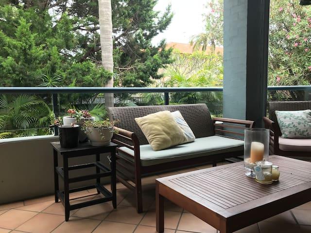 Balcony - spacious area overlooking garden, outdoor kitchen inc BBQ and Sink.