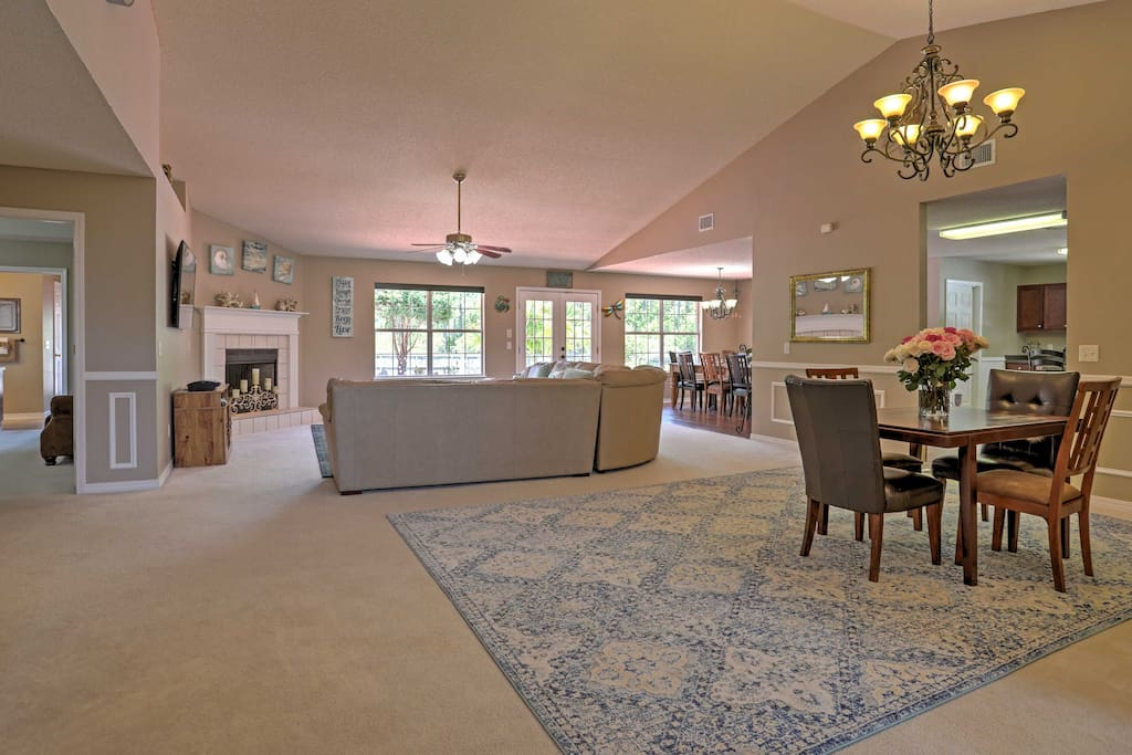 The impressive interior features an open floor plan and vaulted ceilings.