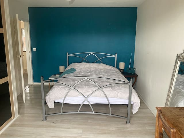 This is the master bedroom which has the balcony overlooking the front garden and looking out to sea