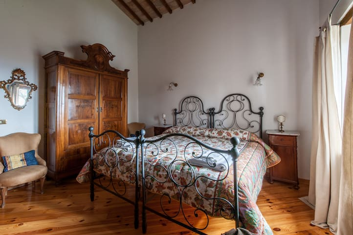 Room # 2 - the double bed in wrought iron