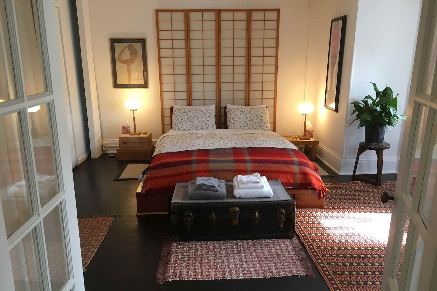 Spacious bedroom with Japanese platform bed and new comfortable organic mattress, french doors, walk in closet and en-suite bathroom.