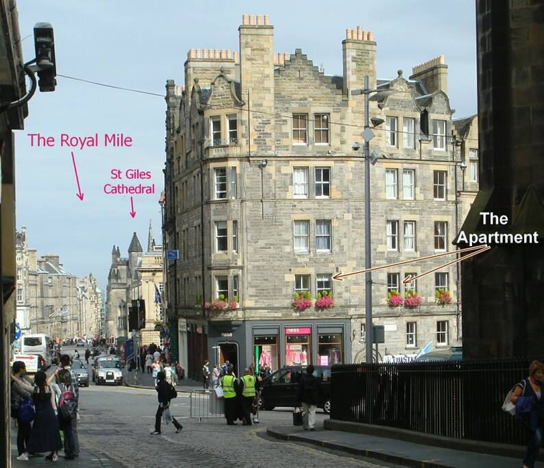 The windows of the apartment.  To the left, the view down the Royal Mile