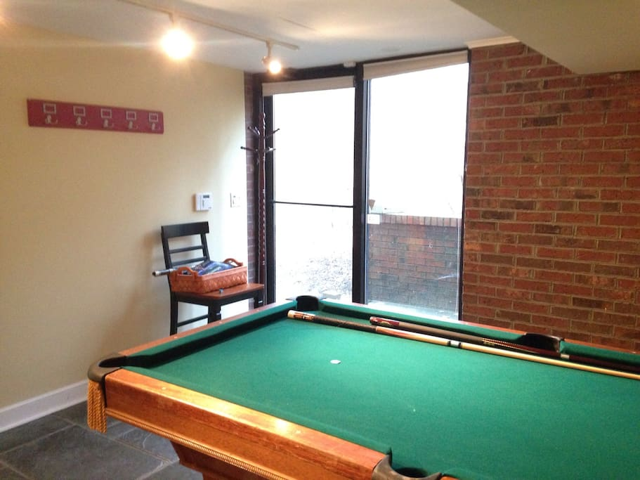 Pool table and entrance way.