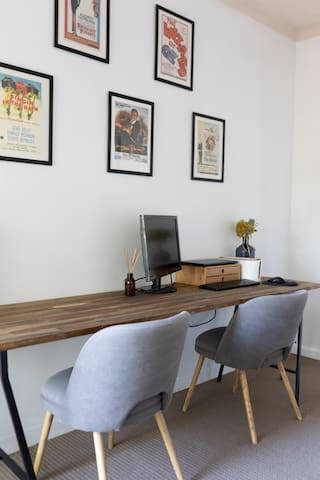 Office with large desk and adjoining balcony—natural light aplenty