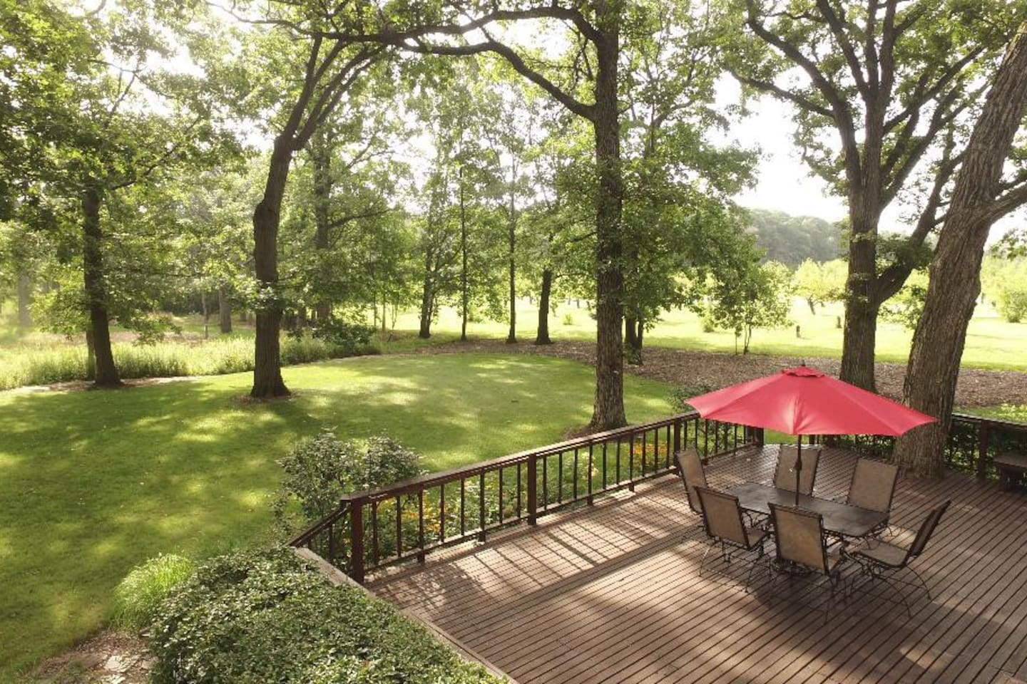 Large Wooden Deck with Outdoor Dining and Grill