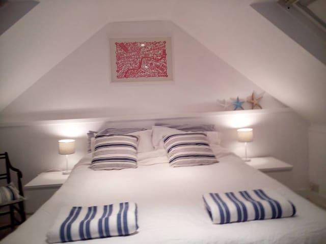 En suite  bedroom, sea views and crashing waves.