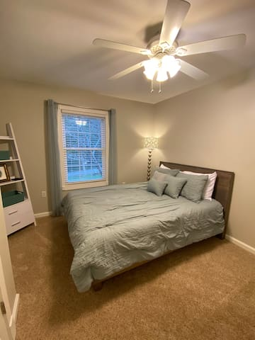 Cozy third bedroom with queen memory foam mattress and flatscreen television
