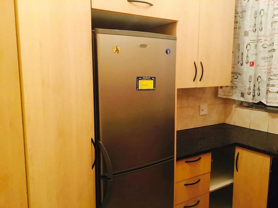 Fitted kitchen with a seperate fridge.