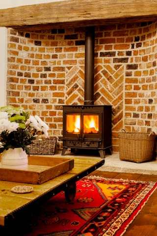 Warm and cosy log burner in the lounge.