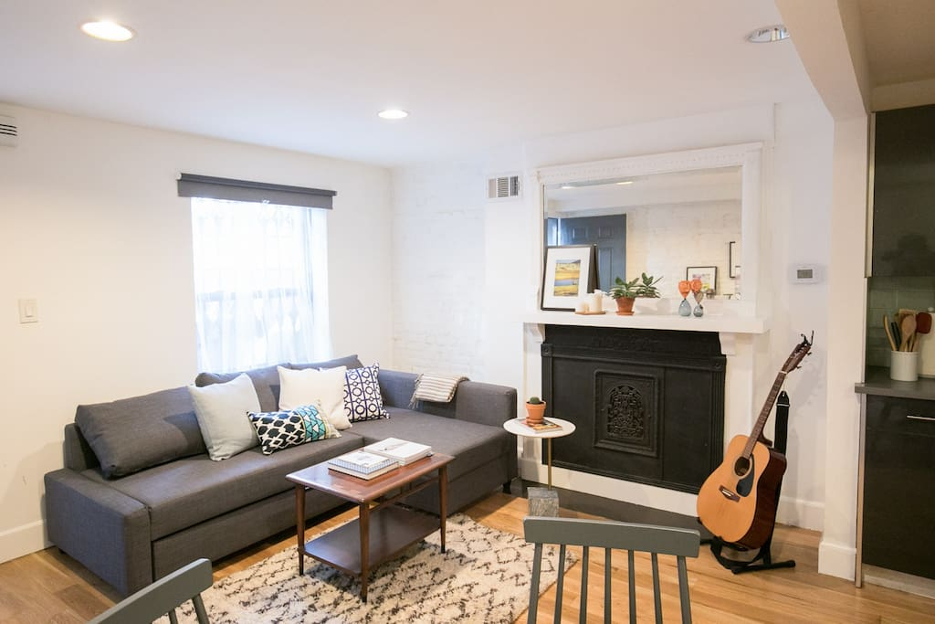 The apartment is newly renovated but features a lot of original details like exposed brick and a fireplace.