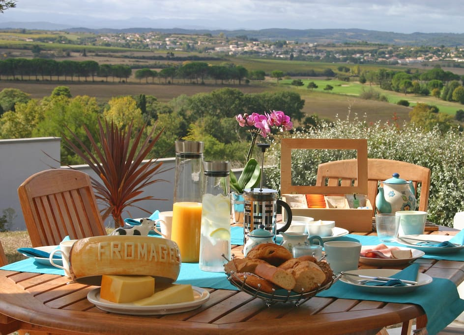 Family breakfast table on terrace, weather permitting