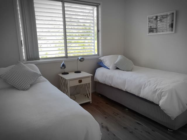 The second bedroom has 2 single beds.
