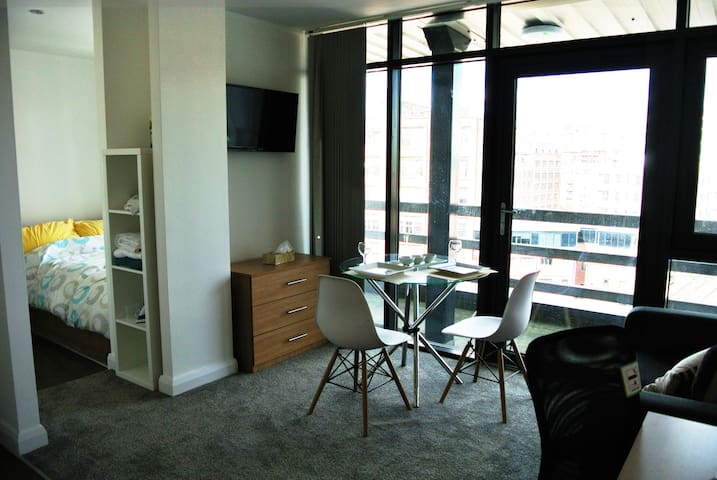 City centre studio penthouse with lovely balcony