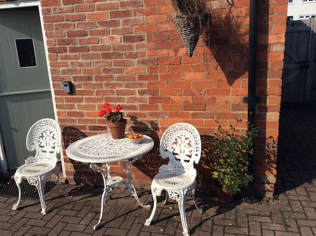 Outside seating area, private entrance to your rooms, and key-safe.