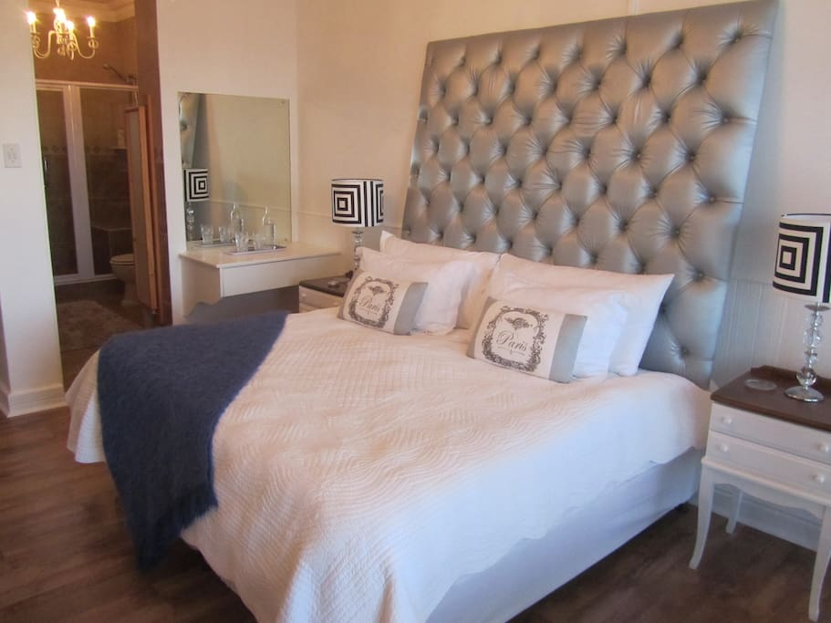 Bedroom 1 with TV, Air-conditioning and en-suite bathroom with shower