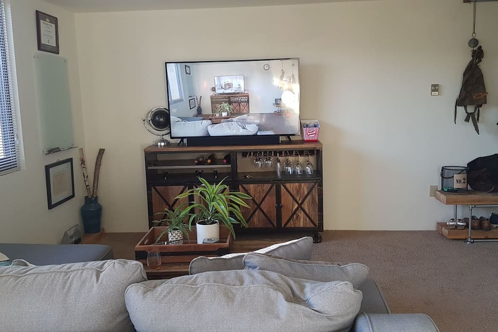 Comfortable couch and entertainment center