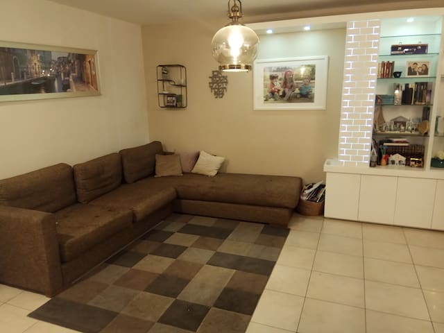 Living room with large couch, clean, Table for 8+