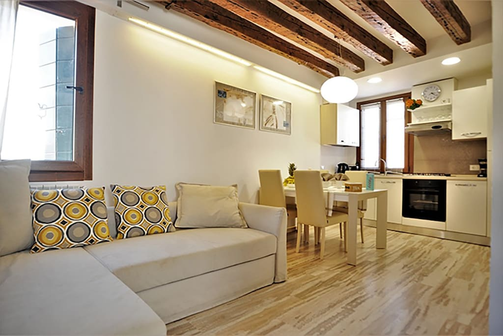 Living room and kitchen with free fast Wi-Fi, TV and air conditioning