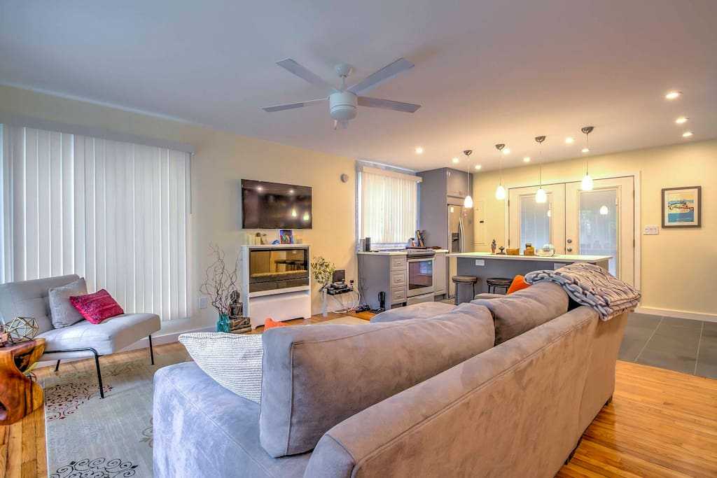 Kick back on the large living room sofa and enjoy a movie on the flat-screen TV or sip a leisurely glass of wine by the fireplace.