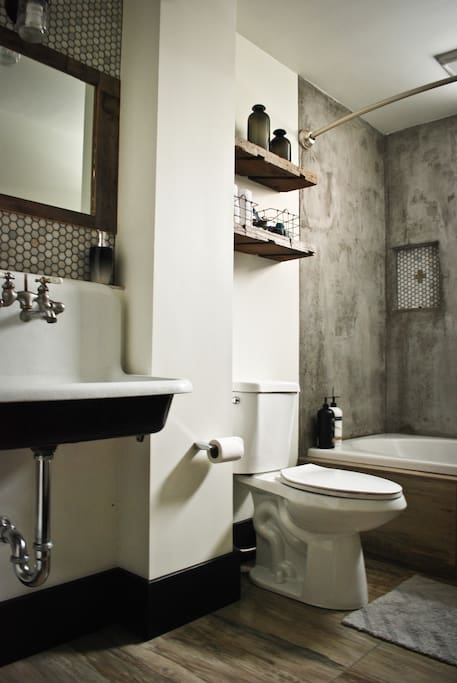 Awesome custom bathroom! Includes concrete walled tub/shower.  Perfect for a soak.
