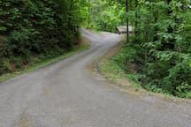 The road to the cabin is gently sloped and fully paved for easy access.