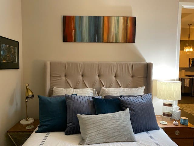 A closeup of the queen-size bed in the room