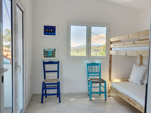 Another bedroom with direct exict on the upper terrace, facing the Saronic Gulf. Bunkbeds, ideal for kids.