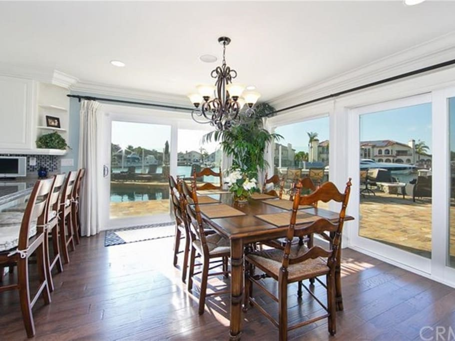 Exquisite dining room with floor to ceiling water views.