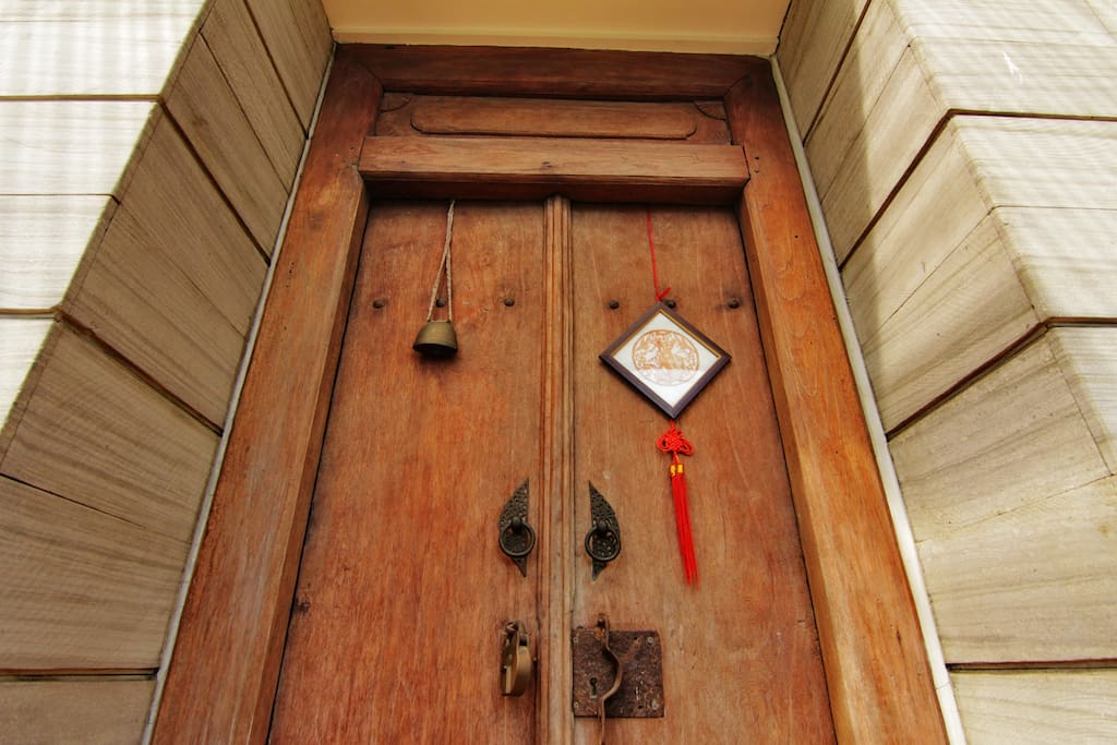 Welcome to Raben House. Enter the house through the antique door from Demak ( area in central Java)